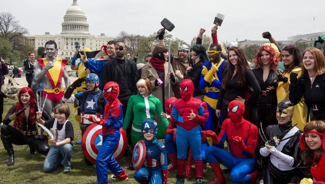 People dressed in superhero-style costumes near the US Capitol in  Washington, DC.