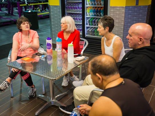 Karen Hartigan chats with  Brenda Stock, Debbie Barnes-Zapata,