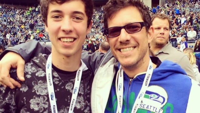 Stefan Lessard, bass player for the Dave Matthews Band, and his son, Diggy.