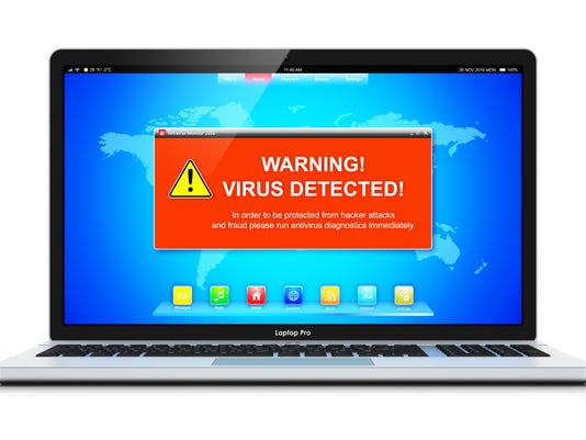 Laptop with virus attack warning message on screen