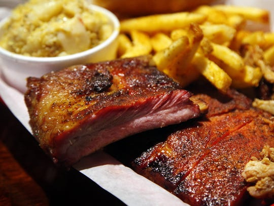 The rib and meat platter with spud sticks and potato