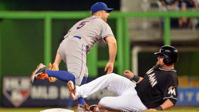 Miami's Casey McGehee, right, is forced out at second base by the Mets' David Wright in the second inning at Marlins Ballpark on Saturday.