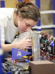 Padua sophomore Melina Trautman works on her team's robot before a First Tech Challenge meet at Padua Academy Nov. 14, 2017.