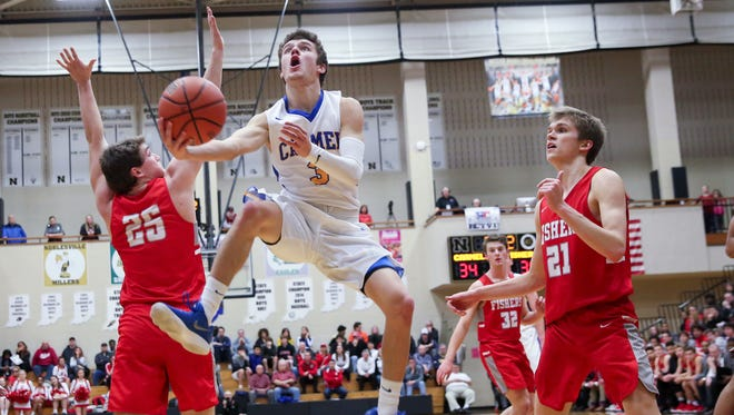 Cole Jenkins makes his way to the basket in Carmel's sectional title win over Fishers on Saturday at Noblesville High School.