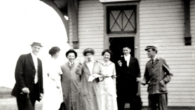 A bridal party poses for pictures outside of Harmony's train depot in 1914.