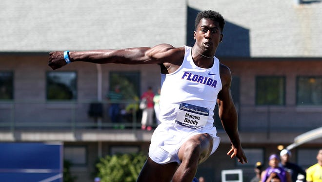 Florida's Marquis Dendy, a Middletown High graduate, leaps on his way to winning the triple jump during the NCAA track and field championships Friday in Eugene, Ore.