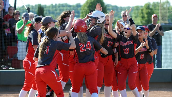 Sheridan players swarm Liv Johnson at the plate after Johnson's go-ahead, two-run home run in the Generals' 2-1 win over Fairfield Union last week. Sheridan faces Lakewood in the Division II regional semifinal at 5 p.m. Thursday at Pickerington Central.