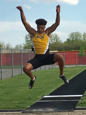 Avon's Isaac Guerendo leaps 23-10 to repeat as long jump champion.