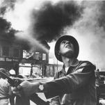 One of the most famous images from the 1967 Detroit riot, captured by Free Press photographer Tony Spina.