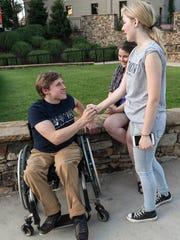 Ben Otto Sunderman, left, gets encouragement from Anna