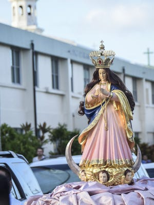 In this December 2014 file photo, the karosa with the Santa Marian Kamalen statue is pulled through the streets of Hagatna during the annual procession to celebrate the Feast of the Immaculate Conception.