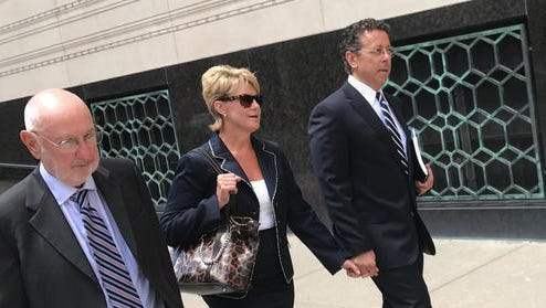 Alphons Iacobelli, far right, leaves the U.S. District Court in Detroit on Aug. 1, with wife Susanne Piwinski-Iacobelli and lawyer David DuMouchel.