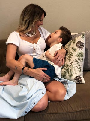 Shelley Carter and her 5-year-old daughter Berkeley enjoy a moment together. Carter has designed an adaptive clothing line aimed at helping parents dress their special needs children.