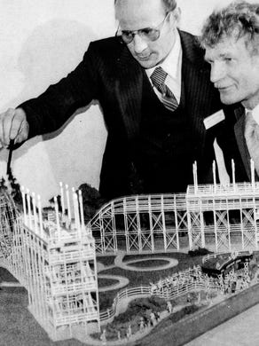 1977: Larry B. Cochran, vice president and general manager of Six Flags Great Adventure, and Arthur Thuijs, the company's art director, check out the model of Lightning Loops.