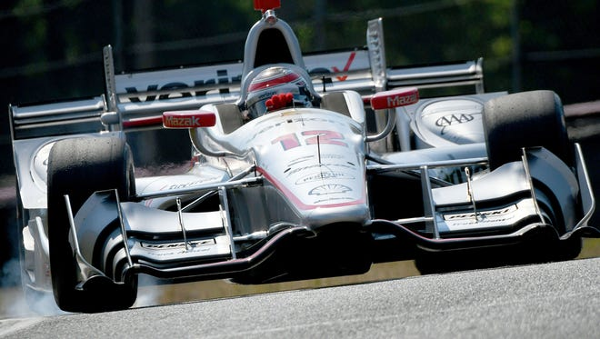 Will Power steers his car around the track at the Mid-Ohio Sports Car Course during a morning session for the Honda Indy 200 at Mid-Ohio on July 29, 2016.