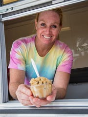 Brandy Vaincourt of Malone, New York, serves up some gluten and egg free raw cookie dough from 4 Dogs Desserts at the Champlain Valley Fair in Essex on Tuesday, August 29, 2017. 4 Dogs Desserts is one of four new food vendors at the fair this year.