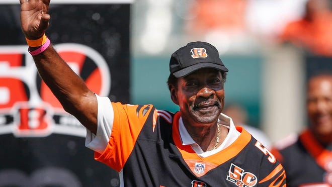 Former Cincinnati Bengals cornerback Ken Riley, seen here waving to the crowd at Paul Brown Stadium during a halftime ceremony in 2017 to mark the team's 50th anniversary, has died at age 72. Riley's 65 career interceptions remain the most in team history and fifth overall in NFL history.