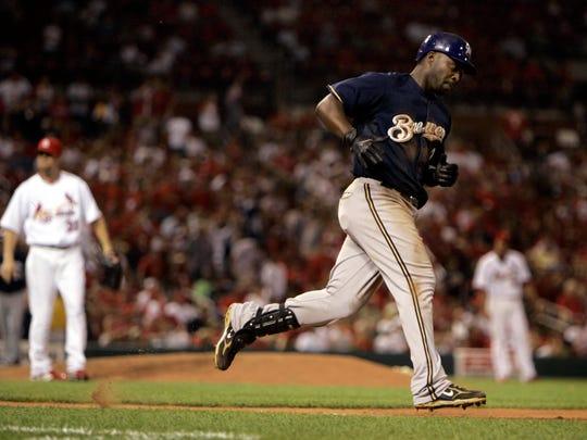 Milwaukee Brewers' Bill Hall, right, rounds the bases after hitting a solo home run off St. Louis Cardinals relief pitcher Ryan Franklin, left, during the 10th inning of a baseball game Monday, July 21, 2008, in St. Louis.