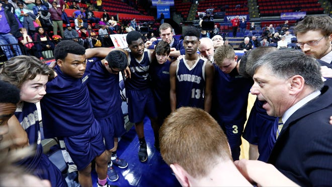 Our Lady of Lourdes head coach James Santoro, right, talks to his players after their 54-43 loss to Irondequoit in the NYSPHSAA boys Class A final at Floyd L. Maines Veterans Memorial Arena in Binghamton on Sunday, March 19, 2017.