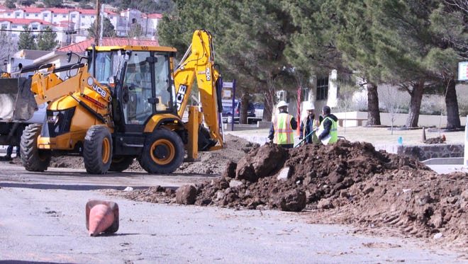 College Avenue, west of A street is being ripped apart to install a new eight inch water main. Above, the Town of Silver City employees work on getting this done Tuesday afternoon.