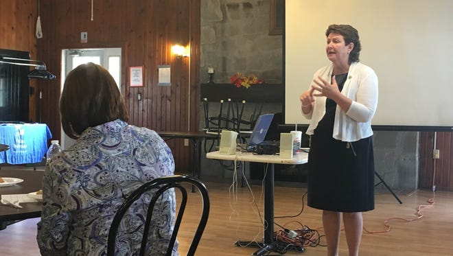 Carol Pool, a prevention specialist from Prevent Child Abuse Indiana, talks Oct. 11, 2016, about bullying during a Indiana Youth Institute Youth Worker's Café in Winchester, Indiana.