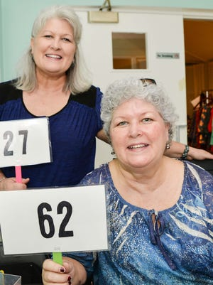 Fort Pierce Woman's Club members Ramona Rowe and Romana Hansen prepare for the Dec. 14 Quarter Auction to benefit Hacienda Girls Ranch.