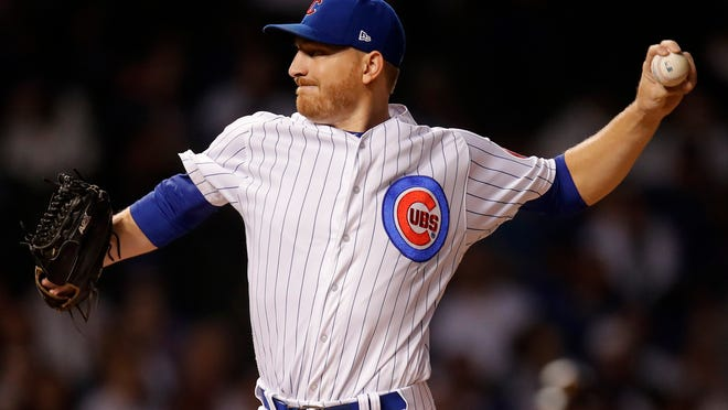 Chicago Cubs' Mike Montgomery pitches to a Pittsburgh Pirates batter during the first inning of a baseball game Tuesday, Sept. 25, 2018, in Chicago. (AP Photo/Jim Young)