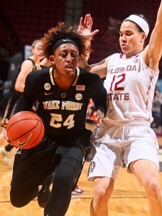 Wake Forest guard Kelila Atkinson (24) is pressured by Florida State guard Brittany Brown (12) and kept from making a shot in the fourth quarter of an NCAA college basketball game in Tallahassee, Fla., Thursday, Feb. 9, 2017. (AP Photo/Phil Sears)