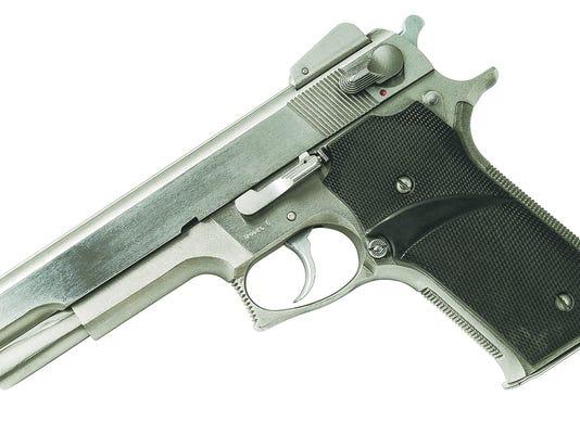 635484780440360002-handgun