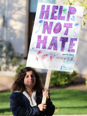 Sandy Khabbazeh, a Syrian refugee, who came to the USA as on student visa about one year ago, takes part in a walk organized by The Take Ten Campaign, a project of the Interfaith Refugee Resettlement Coalition of Highland Park and New Brunswick, which was created to help tackle the growing global refugee problem. The walk, which raised funds, started on South Second Avenue, outside the Highland Park Reformed Church.