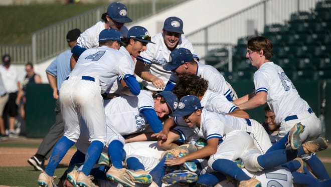 Canterbury School baseball players celebrate winning their second straight state title with a win over University Christian in the 3A State Championship baseball game on Saturday, May 27, 2017, at Hammond Stadium in south Fort Myers.