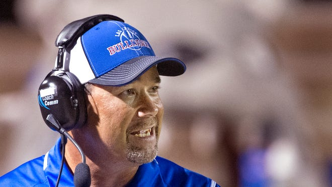 Las Cruces High School had football coach Jim Miller keeps an eye his team Thursday night at the Field of Dreams.