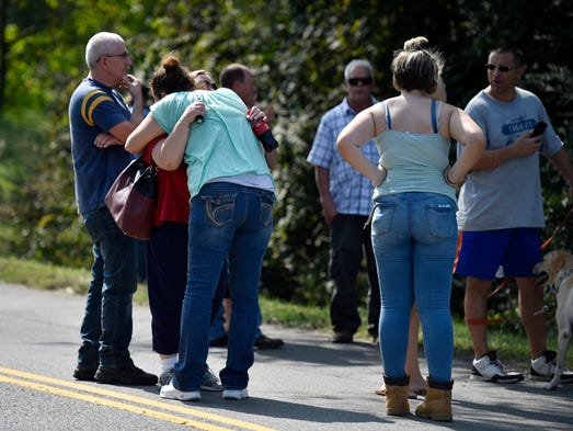 People console each other at the scene where multiple