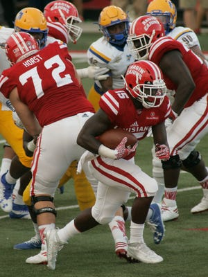 Grant Horst (72) and the UL offensive line block for running back Elijah McGuire in UL's win Saturday over McNeese State