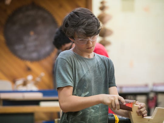 Alex Pine, 13, works in the carpentry class as New Castle County middle schoolers in 6th and 7th grades learn technical skills at the Build Your Future! Construction Technologies Camp held at Delcastle Technical High.