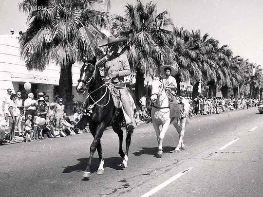 Frank Bogert and daughter Donna all dressed up and riding in the Desert Circus parade, 1963.