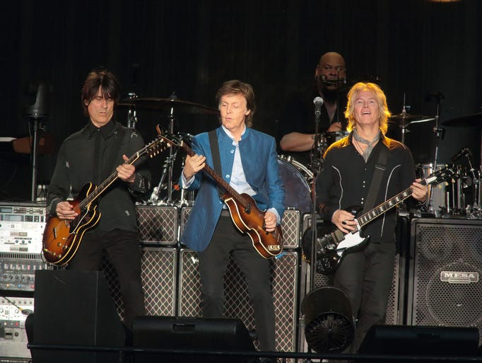 Rusty Anderson, from left, Paul McCartney and Brian