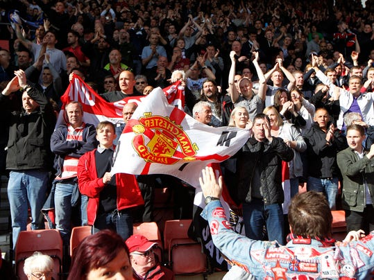 Manchester United's supporters cheer on their team at the end of their English Premier League soccer match against Southampton at St Mary's stadium, Southampton, England, Sunday, May 11, 2014. (AP Photo/Sang Tan)