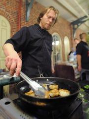 Chef Brad Gates prepares scallops at Indianapolis City