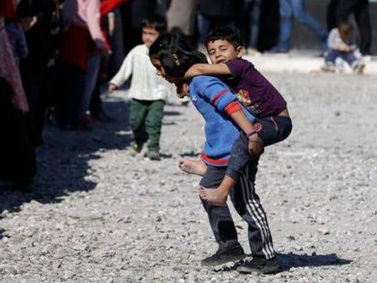 635919908976889946-Greece-Migrants.jpg