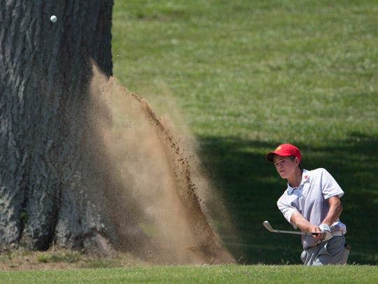 Mater Dei's Isaac Rohleder hits out of the bunker onto the seventh green during the boys' sectional at Oak Meadow.