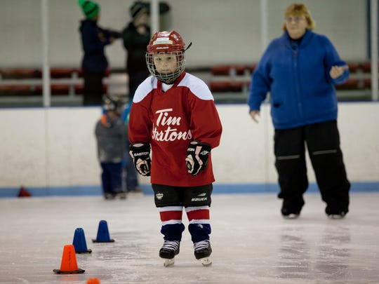 Charley Betts, 5, of Fort Gratiot, skates between cones during a beginner class Tuesday at Glacier Pointe.