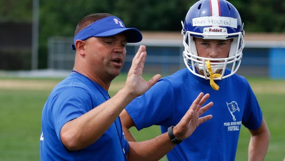 Pearl River head coach Mike Oliva instructs quarterback