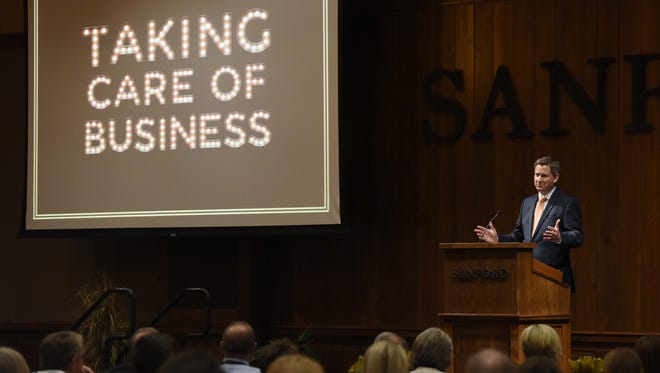 Pat Costello, commissioner of the South Dakota Governor's Office of Economic Development, speaks April 13 at the GOED conference at the Sanford Research Center in Sioux Falls.