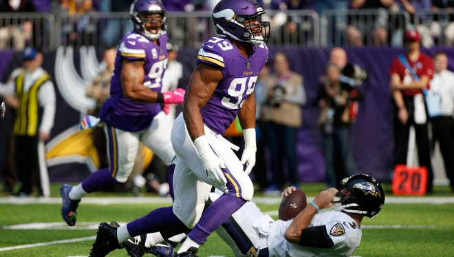 Vikings defensive end Danielle Hunter celebrates after sacking Ravens quarterback Joe Flacco.