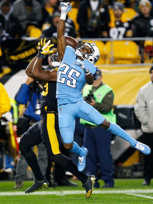 Tennessee Titans cornerback Adoree' Jackson (25) breaks up a pass intended for Pittsburgh Steelers wide receiver JuJu Smith-Schuster (19) during the first half of an NFL football game in Pittsburgh, Thursday, Nov. 16, 2017. (AP Photo/Keith Srakocic)