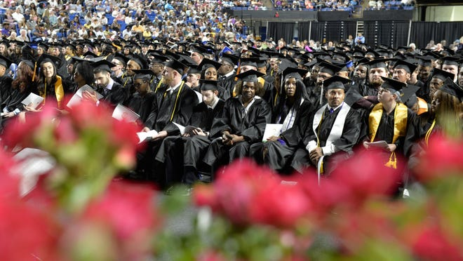 Augusta Technical College students wait to pick up their diplomas during Augusta Tech Commencement Exercises at the James Brown Arena in Augusta, Ga., Wednesday afternoon May 8, 2018.