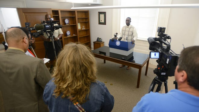 FILE -- Jackson Mayor Tony Yarber addresses reporters at City Hall.
