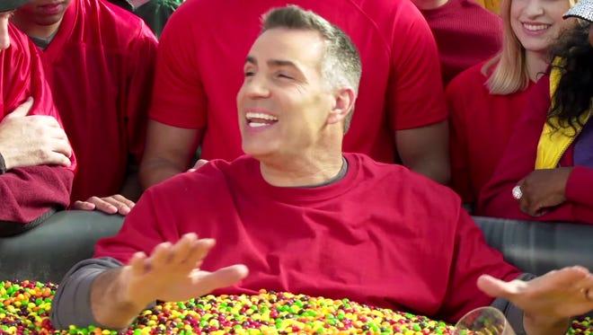 Kurt Warner is partying with Skittles.