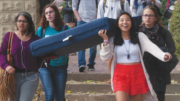 Students carrying a mattress for a Carry That Weight event at Georgetown in October 2014